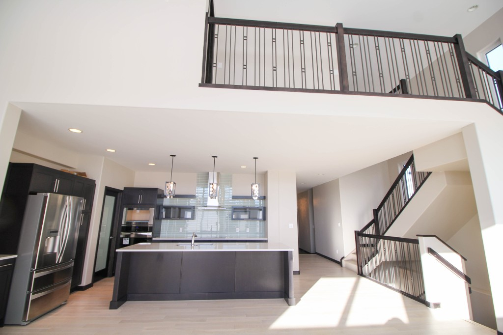 Soaring ceilings, main floor open concept layout