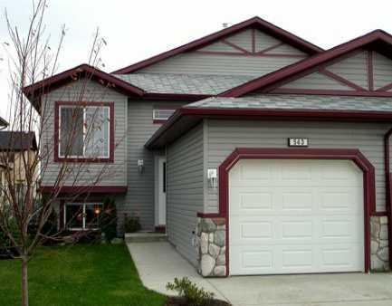 Main Photo: 543 STONEGATE Way NW: Airdrie Residential Attached for sale : MLS(r) # C3580927