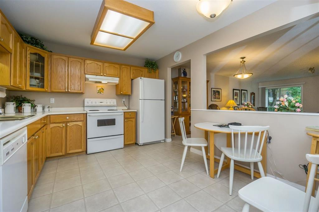Main Photo: 106 19645 64 Avenue in Langley: Willoughby Heights Condo for sale : MLS®# R2003423