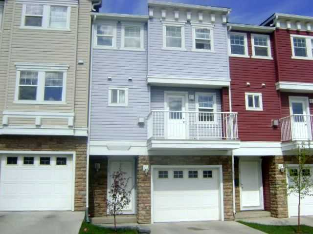 Main Photo: 19 TUCKER Circle in : Okotoks Townhouse for sale : MLS(r) # C3570274