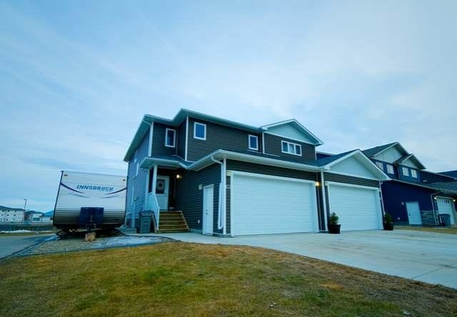 Main Photo: 63 Wellwood Drive in Whitecourt: House Half Duplex for sale : MLS® # 42850