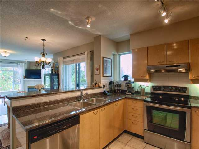 "Main Photo: 201 3625 WINDCREST Diversion in North Vancouver: Roche Point Condo for sale in ""WINDSONG PHASE 3 RAVENWOODS"" : MLS®# V945947"