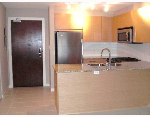 Photo 2: # 101 5889 IRMIN ST in : Metrotown Condo for sale : MLS® # V794308
