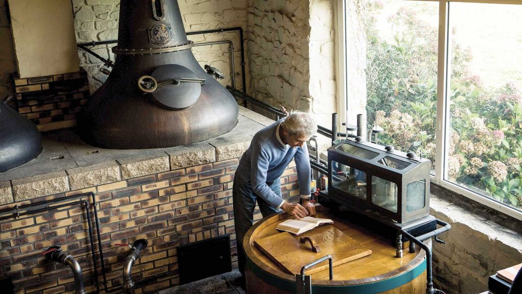 jean donnay of glann ar mor distillery takes notes by the pot still
