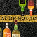 bottles of scotch arranged across a yellow road line with the words to peat or not to peat