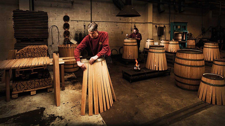 Swedish master cooper Johan Thorslund constructs a whisky barrel.