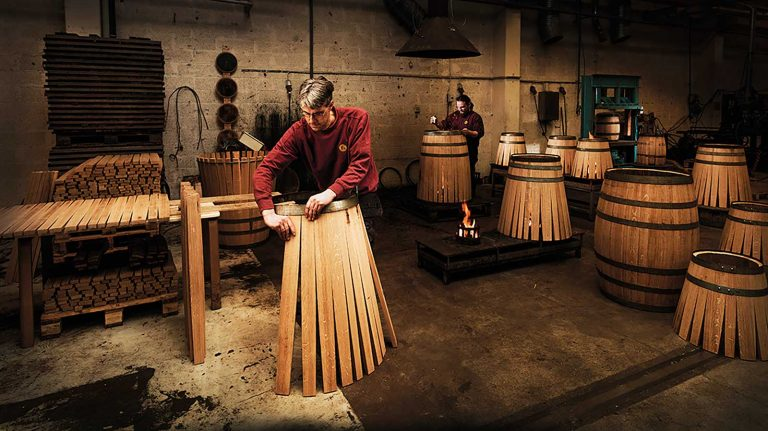 Swedish master cooper Johan Thorslund constructs a whisky barrel.