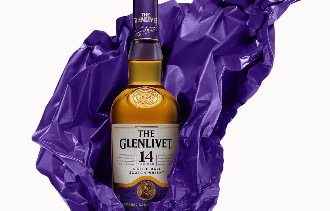 glenlivet 14 year old scotch in purple tissue paper