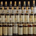 Three rows of rare Macallan scotch whisky slated for auction at Sotheby's