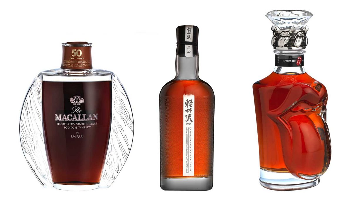 A lineup of Macallan in Lalique, old Karuizawa, and a Rolling Stones Suntory bottle
