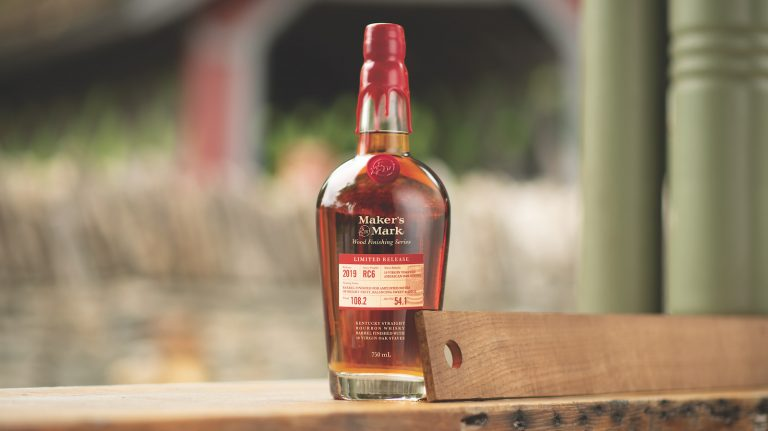 a bottle of maker's mark wood finished series 2019 release RC6 stave bourbon, with an oak stave