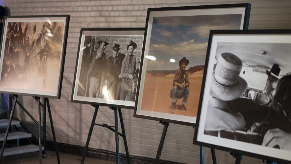photos on easels of John Wayne in Western movies