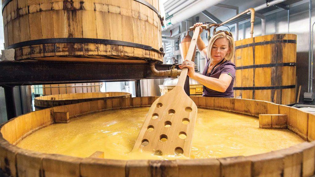 Head distiller Connie Baker stirs the mash at Marble Distillery in Carbondale, Colorado.