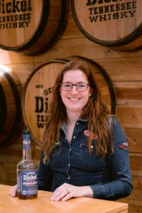 George Dickel general manager and distiller Nicole Austin stands behind the George Dickel booth at WhiskyFest New York 2019 on Dec. 3, presenting a bottle of Whisky Advocate's Whisky of the Year—George Dickel 13 year old Bottled in Bond, distilled in fall 2005.