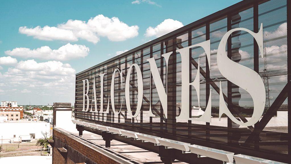 "A large sign reading ""Balcones"" indicates the Balcones Distillery in Waco, Texas."