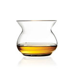 The Neat Artisan Spirits Glass has a flared mouth and is shown holding about an ounce of whiskey.