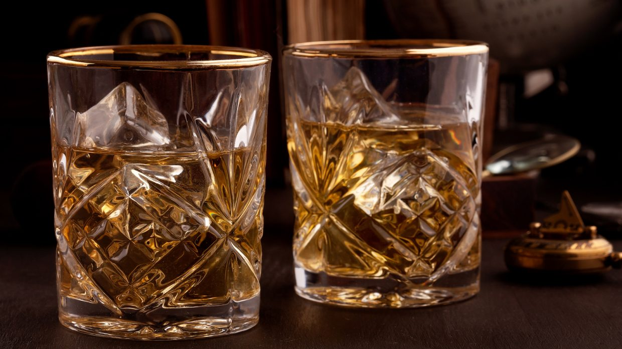 Two glasses of whiskey in the library