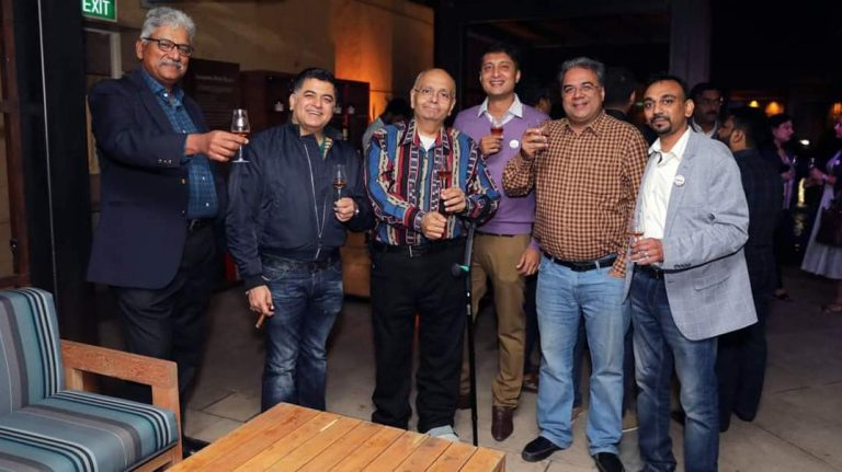 Members of the Single Malt Amateurs Club of Bangalore, India, with glasses of whisky