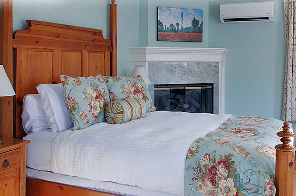 View of the queen bed in our two-story Newport RI suite