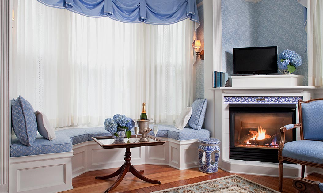 Bay Window Seat and Gas Fireplace in Our Newport RI Suite