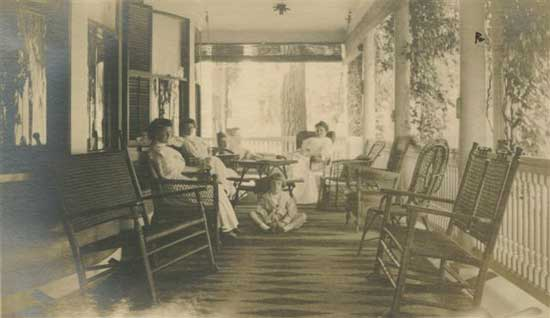 The Front Veranda in 1909 when the Flint family owned the house. The rocking chairs still exist!