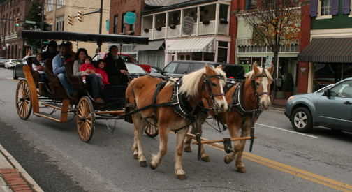 Free Carriage Rides leaving the Misitletoe Market in the Community Market Parking Lot