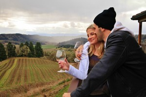 Couple drinking wine in Oregon at Youngberg Hill.