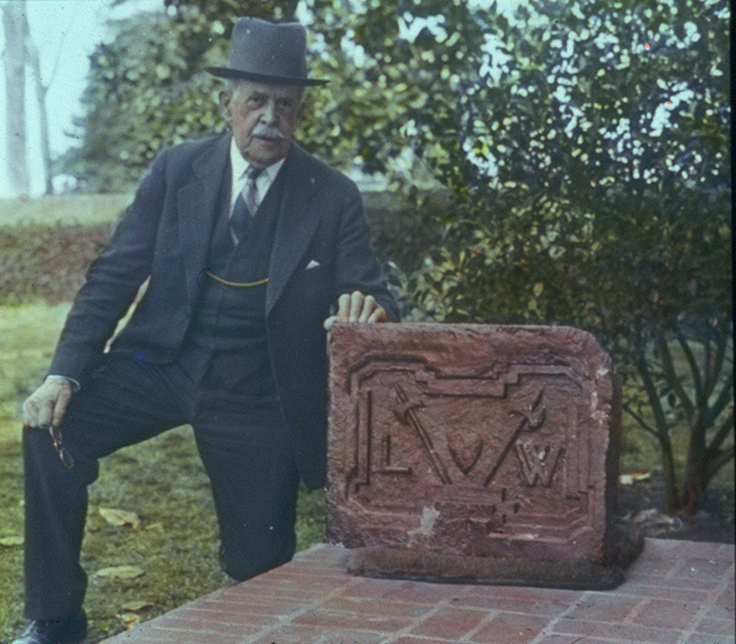 Dodge with the Mansion's cornerstone.