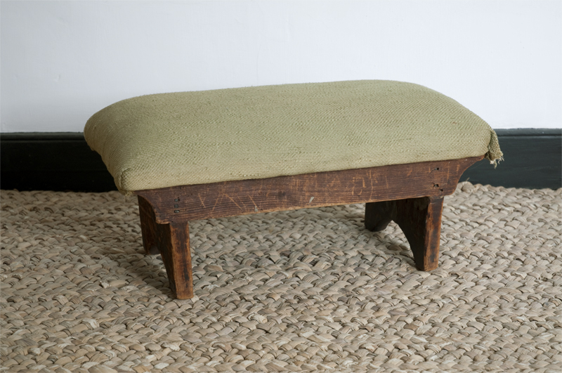 This footstool came from the church pew where President Washington once sat in Trinity Church, New York, New York. The stool postdates Washington's occupancy of the pew, but according to the last owner, it was found or acquired by a member of the Van Horne family who rented the space after Washington's departure. Washington worshiped regularly at Trinity for a short period of time in 1790. Footstool originally from Trinity Church, 1800-1850, white pine, wool, and linen, H-192, MVLA.