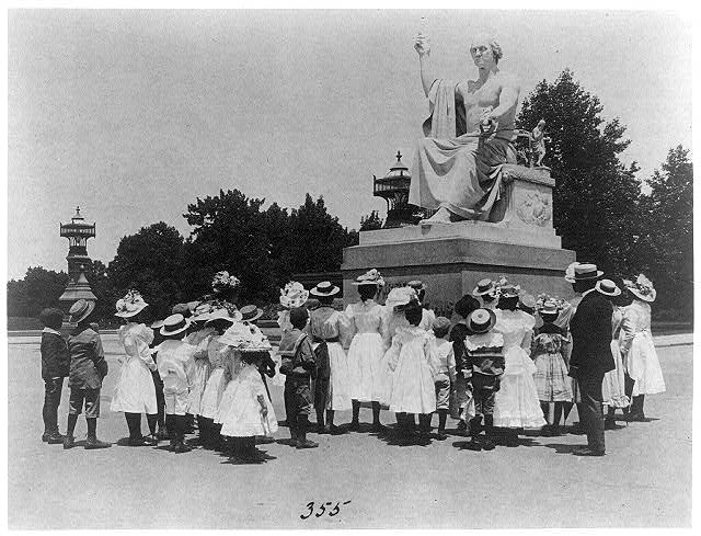 African American school children facing the Horatio Greenough statue of George Washington at the U.S. Capitol by Frances Benjamin Johnston, c. 1899, Library of Congress.