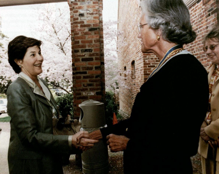 Mrs. Laura Bush is welcomed by the Regent, Ellen Walton, and Carew Lee, the Vice Regent for Maryland (Official White House Photo)