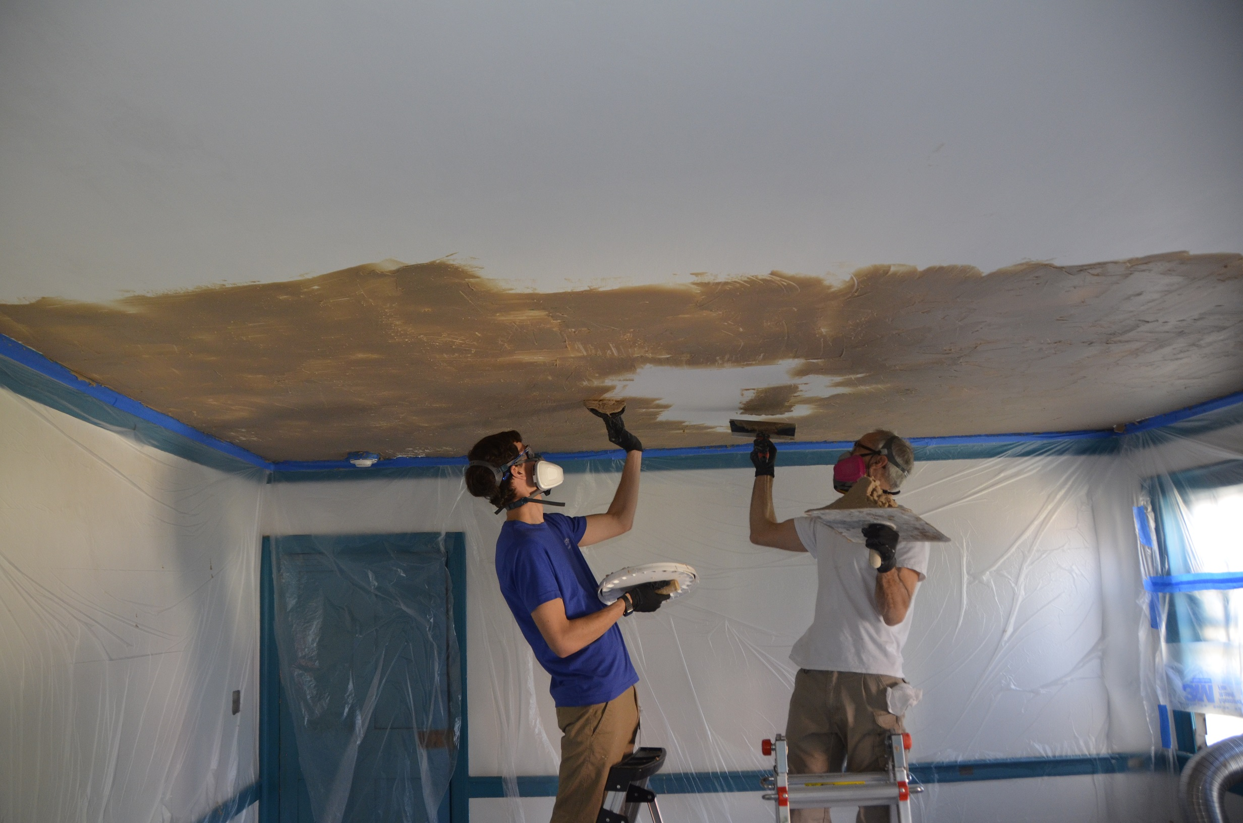 Preservation Specialist, Eric Litchford, and Conservation Specialist, Andy Compton, apply a stripping agent to the Blue Room ceiling.