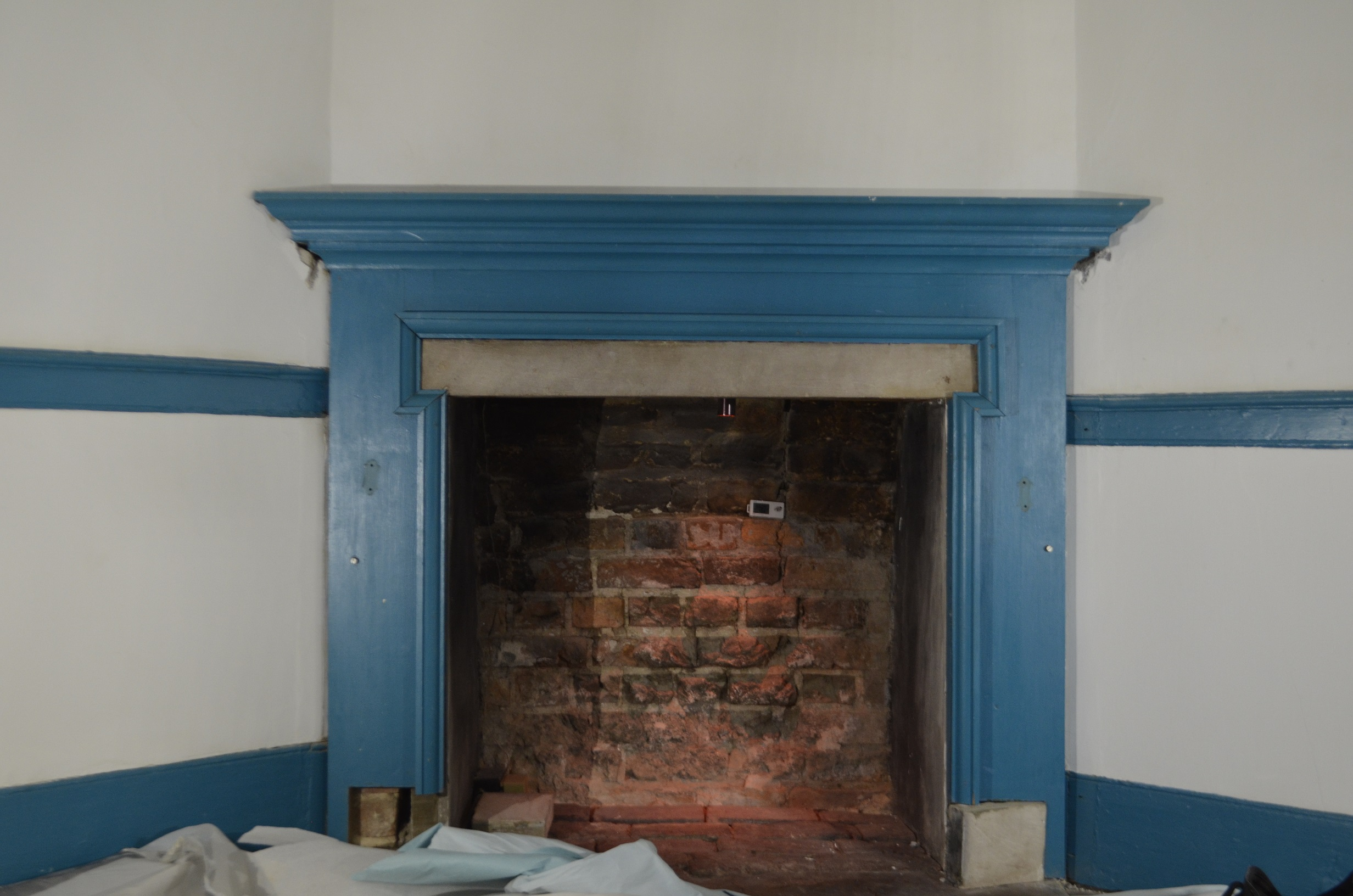 20th-century mantel with one plinth block removed in the bottom left corner.