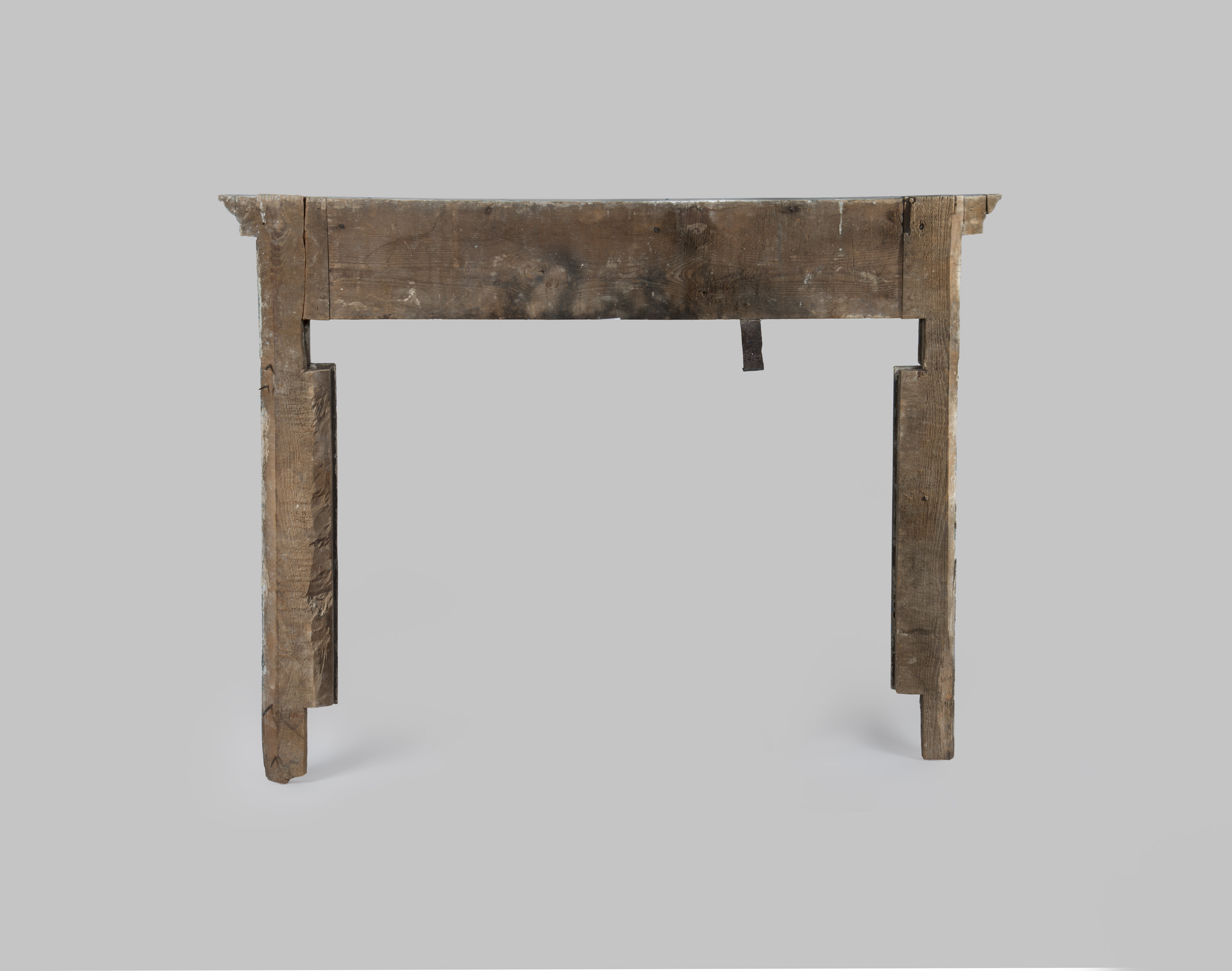 Studio photograph of the back of the 1776 Blue Room mantel prior to reinstallation. At left, the large crack is visible in the left leg close to where it joins the header; both legs were secured to the header using pegged mortise-and-tenon joints.