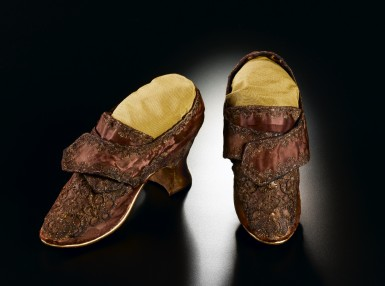 Made of purple silk, these shoes are believed to have been worn by Martha Dandridge Custis during her wedding to George Washington. They not only reflect Martha's status as a wealthy widow but also her youthful exuberance. (Mount Vernon Ladies' Association)