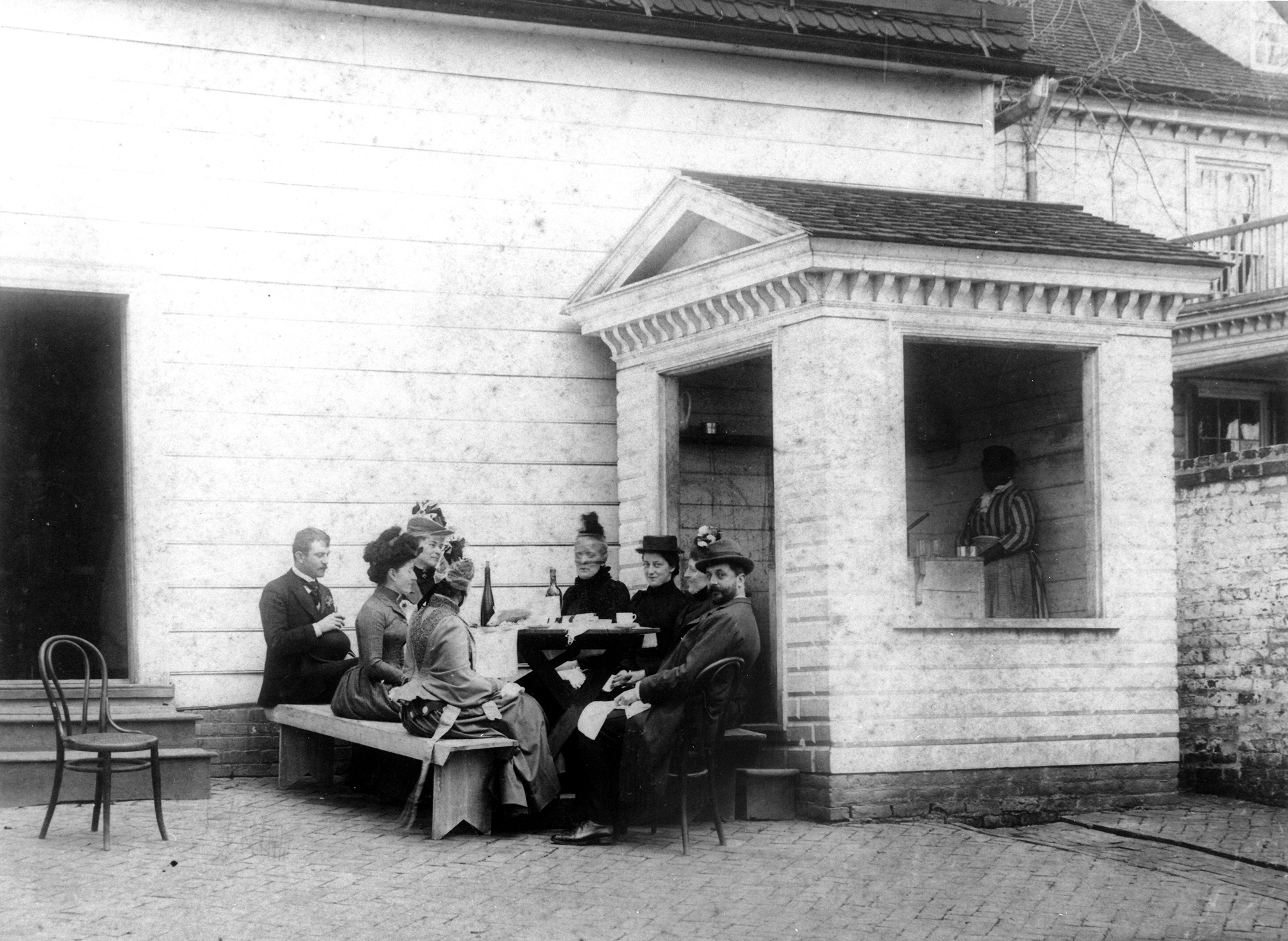 Some time in the late 19th century, a group of visitors gather for refreshments next to the well house located just outside Washington's kitchen. Though small by today's standards, this addiitonal stream of income helped to balance Mount Vernon's budget. Photo by Luke Dillon.