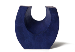 Picture of a beautiful purple horseshoe shaped biodegradable paper cremation urn on sale at Muses Design Urns. Front view.