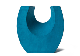 Picture of a beautiful aqua horseshoe shaped biodegradable paper cremation urn on sale at Muses Design Urns. Front view.