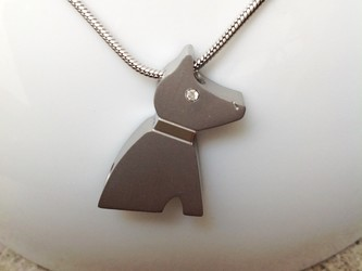 Picture of a Stainless Steel  cremation jewelry with a dog pendant for ashes