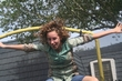 a picture by my kid brother of me on the trampoline - Crazy Curls Contest