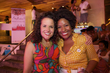michelle and cassadie pose together for a photo at the curly pool party -