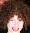 curly kid -