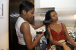 curly receives tlc on her curls at the curly pool party - Black hair