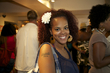 curly accentuates curls with flower at curly pool party - Medium hair styles