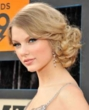 taylor swift sports short curly updo -