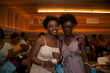 2 naturals pose to show off updos at curly pool party - updos