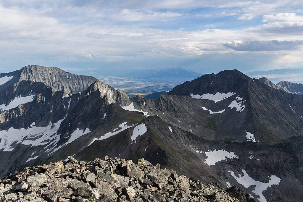 Looking south from the summit. Iddings Peak (10,936′) on the left and Wilsall Peak (10,571′) on the right. Absarokas in the background.