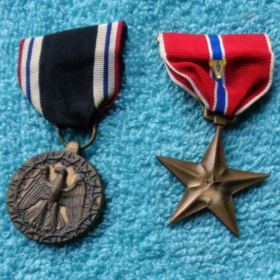 Lawrence Poulin (Larry), WT3c - Of all the medals, awards, formal presentations and qualification badges you received, or other memorabilia, which one is the most meaningful to you and why?