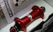NS Bikes Afterburner front hub - Red