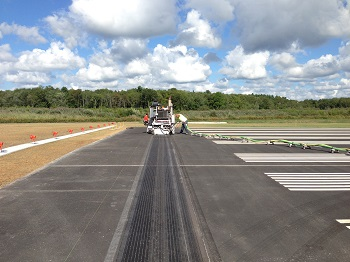 The first set of grooves is cut into the new Runway 5/23